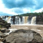 Looking for the best waterfalls in India? Visit Gira Waterfalls in Gujarat, a seasonal Indian waterfall that looks its gorgeous best right after rains. Beautiful Gira falls makes for an amazing getaway right after monsoons. #India #Waterfalls